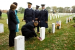 President Obama pauses during a visit to Arlington National Cemetery on November 11, 2009, to leave a Presidential coin in front of the tombstone of 19-year-old Medal of Honor recipient Specialist Ross McGinnis. | Official White House photo by Pete DeSouza.