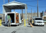 Centerra protective force personnel conduct a vehicle inspection to prevent the introduction of prohibited items into a limited area at SRS. The canine team is trained to detect the presence of explosives and assists with vehicle and package inspections.