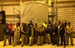 The HLW Relocation and Storage Project crew poses in front of the 56th and final cask containing vitrified high-level waste awaiting transfer to an onsite storage pad.