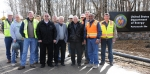 The Pike County Commissioners recently toured the construction site of the county's new sewer line extension being installed. Shown with team members from contractors FOILL Construction, Stantec, and Fluor-B&W Portsmouth in the background are, front row, left to right, Dennis Carr of Fluor-B&W Portsmouth; Commissioners Teddy West, Blaine Beekman, and Harry Rider; EM Site Lead Joel Bradburne; EM Site Director Dr. Vince Adams; and Rick Ginther of Fluor-B&W Portsmouth.
