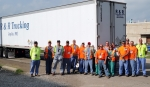 Waste management and transportation personnel worked late to complete the first shipment to WCS. Through a contract with DOE, WCS will treat and accept potentially hazardous waste that has been at the Portsmouth site for decades. Pictured (from left) are Scott Fraser, Joe Hawes, Craig Herrmann, Jim Book, John Lee, John Perry, Josh Knipp, Melissa Dunsieth, Randy Barr, Rick Williams, Janet Harris, Maureen Fischels, Cecil McCoy, Trent Eckert, Anthony Howard and Chris Ashley.