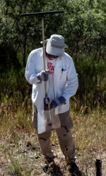 Sampling locations are on steep, heavily vegetated terrain requiring subcontractor TerranearPMC crews to take hand-augured samples rather than using a drill rig.