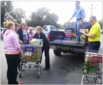 U.S. Department of Energy and contractor staff prepare shipments of food to local pantries as part of the Portsmouth Site's 2014 Feds Feed Families effort.