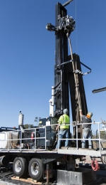 Workers reached a record-breaking depth of 1,100 feet with a sonic drill rig.