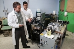 Researchers demonstrate General Electric's magnetocaloric system.   Photo courtesy of General Electric
