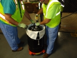 Fluor-BWXT Portsmouth workers seal the HEUFS material into a sealed waste container.