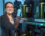 Photo of Amanda Barry inside of an algae lab.