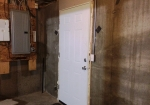 An insulated door was an easy upgrade from the steel cellar door that let cold air into our house. Photo by Elizabeth Spencer