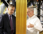 Michael Berube (left), the new director of the Vehicle Technologies Office, and Alan Liby, from Oak Ridge National Laboratory, look at a piece of partially oxidized material in the process of being converted into carbon fiber during a recent visit to the national laboratory in Tennessee.