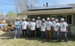 Solar installation supervisors (blue shirts) from GRID worked with tribal volunteers (white shirts) to complete five residential solar PV system installations on the Bishop Paiute Reservation in March 2016. Photo from Gary Bacock, Bishop Paiute Tribe.