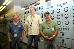 X-326 Facility Manager Jack Tully, left to right, DOE Site Lead Joel Bradburne and Operator Russ Nickell stand in the local control room after the last processing equipment that had been operating in the uranium enrichment cascade at the Portsmouth site in Piketon was shut down.