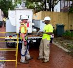 Workers install the final LED streetlight for DC's EECBG-funded energy efficient lighting upgrade. | Energy Department photo, credit Chris Galm.