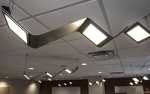 Photo of a ceiling with several OLED luminaires.