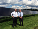EERE Assistant Secretary Dr. David Danielson stands with Senator Bernie Sanders of Vermont at the state's new regional solar test center. | Photo credit Kevin Fitzmaurice, Energy Department.