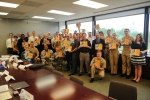 Participants of an energy education meeting at the U.S. Naval Academy hold up the Energy Literacy Framework. | Energy Department photo
