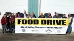 West Valley Demonstration Project has a reputation for strong community involvement. Pictured here are the volunteers who distributed food to seven food banks.