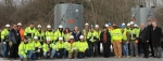 Members of the EM and URS SPRU Project Team gather to celebrate the last shipment of solidified sludge liners today.