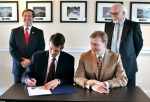 (L to R) U.S. Congressman Chuck Fleischmann, EM's Principal Deputy Assistant Secretary Mark Whitney, CROET CEO Larence Young, and David Klaus, DOE's Deputy Undersecretary for Management and Performance, participate in a signing event that transfers 25 acres for private development at ETTP.