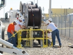 MSA and Benton Public Utilities District linemen set up the cables to be pulled into the vaults.