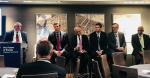 Men talk during a panel about energy and nuclear power.