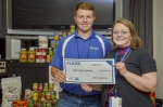 Intern Schubert Moffatt presents Jennifer Woodard, DOE Site Lead, with 2,583 pounds of food collected to support the DOE Feds Feed Families program.