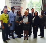 EM's Carol Ward, center, holds a certificate honoring her first-place finish in the 2015 Feds Feed Families Chili Cookoff as she stands with the competition's judges and organizer. Also pictured are EM employees John Lee, far left, and Marlenia Murray, right of Lee, who were recognized for donating 250 pounds of nonperishables to the Feds Feed Families drive.