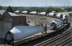 Wind turbine blades wind their way by train through Denver. | Photo by Dennis Schroeder of NREL.