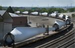 Wind turbine blades wind their way by train through Denver. | Photo by Dennis Schroeder of NREL.