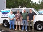 Smart grid technology installations provided not only new work, but new customers for Narrows Electric owner Gary Miklethun, far l., and his team, from l. to r., Ken Dehart, Rodney Thomas and Dave Brosie.