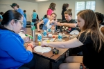 SRNS Structural Engineer Yara Soto-Toledo, left, foreground, works with high school senior Madelyn Cooper at the camp.