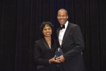 Director Dot Harris presents Chris Smith, Principal Deputy Assistant Secretary and Acting Assistant Secretary of Fossil Energy, with a professional achievement award at the Black Engineer of the Year Awards conference this February. Photo Credit: Nancy Jo Brown/106FOTO