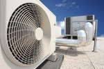 Home air conditioning unit photo on top of a roof