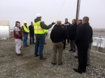 Scott Sax, president of Washington Closure Hanford, center, describes deactivation and decommissioning activities at the 618-10 Burial Ground to CNL decommissioning specialists.