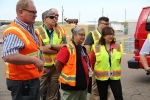 Shirley Perez, a robotic arms operator, center, and EM Assistant Secretary Monica Regalbuto, right, listen to a briefing on the new robotic arms to be installed in EM's Advanced Mixed Waste Treatment Project this fall.