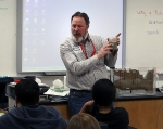 Jeff Wurtz, an NNSS groundwater specialist, uses an ant farm style model to show middle school students how an aquifer works.