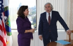 Dr. Monica Regalbuto talks with Energy Secretary Ernest Moniz after she was sworn in as Assistant Secretary for Environmental Management at DOE headquarters in August.