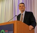 Mark Whitney, Principal Deputy Assistant Secretary for EM, speaks at the National Cleanup Workshop.