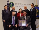 Pictured, front row, left to right, EERE Principal Deputy Assistant Secretary David Freidman and EMCBC Manager Ralph Holland; back row, left to right, EERE Project Management Coordination Office (PMCO) Management Analyst Kara Peralta, Ted Donat, supervisor in PMCO, EM Assistant Secretary Monica Regalbuto, PMCO Director Scott Hine, and EM Principal Deputy Assistant Secretary Mark Whitney.
