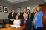 Pictured, front row, left to right, EM Assistant Secretary Monica Regalbuto and DOE Independent Enterprise Assessments Director Glenn Podonsky; back row, left to right: Evan Dunne, National Training Center, Special Projects; Ted Giltz, HAMMER/Mission Support Alliance, DOE Training Institute Manager; Ashley Morris, Richland Operations Office, Senior Advisor for HAMMER; Karen McGinnis, HAMMER/Mission Support Alliance, HAMMER Director; Stacy Charboneau, Richland Operations Office, Manager; and Karen Boardman, National Training Center, Director.
