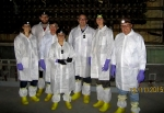 The UK delegation gathers at the front of the H Reactor core. Left to right: Amanda Anderson, DOE Office of the Chief of Nuclear Safety; Paul Lonsdale, Magnox Ltd.; Steve Kirchhoff, DOE Office of Environment, Health, Safety and Security; Mina Golshan, Office for Nuclear Regulation; Tony Handley, Magnox Ltd.; Anna Clark, Nuclear Decommissioning Authority; and Laurie Judd, Longenecker & Associates.