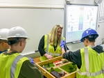 Elizabeth Wyatt, mechanical engineer and senior technical advisor for Fluor Paducah Deactivation Project, helps Ballard County Middle School students understand groundwater and water sampling.