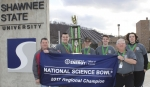 The winning Science Bowl team from Wheelersburg High School displays their victory banner immediately following the South Central Ohio Regional competition.  Pictured (left to right) are: DOE Regional Coordinator Greg Simonton, team captain Jacob Lewis, Gus Shoemaker, Aaron Bundy, coach Paul Boll, and Quin Whitley.