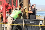 Workers from CH2M subcontractor Stillwater drill a groundwater well in the Hanford Site's 100-N Area.