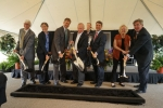Left: Gary Bertoline, Dean of Purdue Polytechnic Institute; Kelly Visconti, Technology Manager for the U.S. Department of Energy Advanced Manufacturing Office; John Dennis, Mayor of West Lafayette; Mitch Daniels, President of Purdue University; R. Byron Pipes, John Leighton Bray Distinguished Professor of Engineering; Victor Smith, Indiana Secretary of Commerce; Leah Jamieson, John A. Edwardson Dean of Engineering; and Dan Hasler, President of the Purdue Research Foundation
