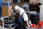 Discussions on safety issues are incorporated into simulated work at the Advanced Mixed Waste Treatment Plant, including when workers learn procedures in mockup situations, such as a practice session on solidifying used hydraulic oil, pictured here.
