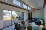 Passive solar design uses carefully designed overhangs and reflective coatings on windows, exterior walls, and roofs to provide comfort during the cooling season.   Photo courtesy of Jason Flakes, U.S. Department of Energy
