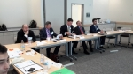 U.S. and Kazakhstani participants follow a briefing about modeling and simulation