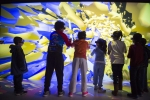 Kids visiting NREL enjoy a 3D Wind Illustration
