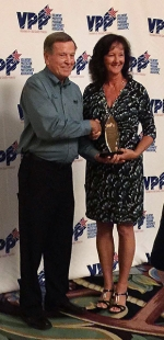 Sharon Kidd, a Savannah River Remediation electrical and instrumentation technician, receives the Safety and Health Achievement Award from VPPPA Board Chairman Mike Maddox at the 31st Annual National Voluntary Protection Program Participants' Association conference held recently in Grapevine, Texas.