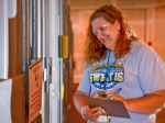 LaChelle Telfair, LATA Kentucky Nuclear Material Control and Accounting representative, takes notes inside a storage facility that contains cold traps removed from the C-410 Feed Plant.